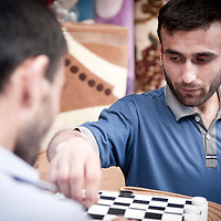 Baku, Azerbaijan, 24 July 2012<br /> Two Azeri men play checkers.<br /> Photo: Ezequiel Scagnetti