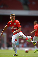 Mesut Ozil of Arsenal during pre-match drills. Barclays Premier League, Arsenal v West Ham Utd at the Emirates Stadium in London on Sunday 9th August 2015.<br /> pic by John Patrick Fletcher, Andrew Orchard sports photography.