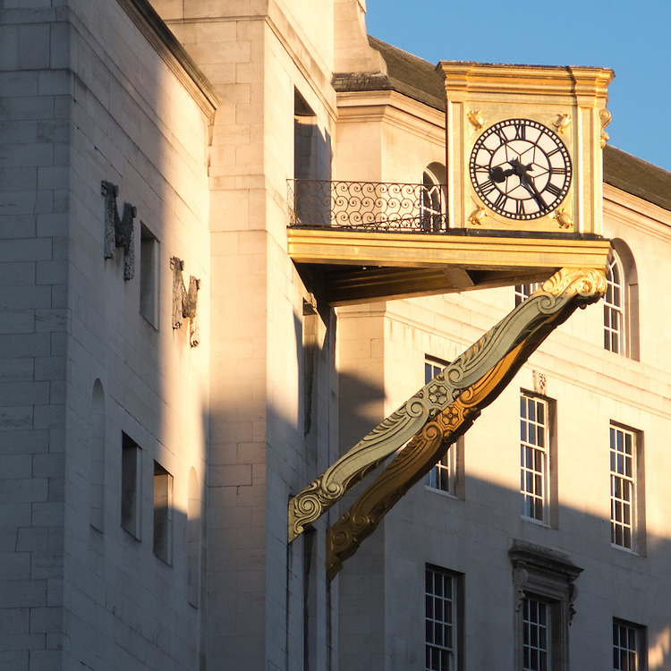 Clock attached to Leeds Civic Hall built in 1933 by Vincent Harris, Leeds, Yorkshire, UK