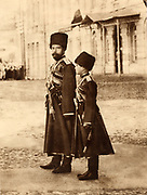 Nicholas II (1868-1918) Tsar of Russia from 1894, and his son the Tsarevich Alexei (1904-1918), reviewing Russian troops, 1915.
