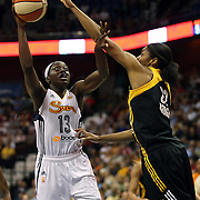 Chiney Ogwumike, (left), Connecticut Sun, shoots past Vicki Baugh, Tulsa Shock, during the Connecticut Sun Vs Tulsa Shock WNBA regular season game at Mohegan Sun Arena, Uncasville, Connecticut, USA. 3rd July 2014. Photo Tim Clayton
