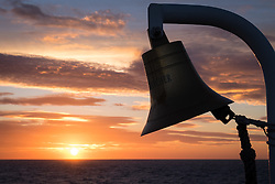 © Licensed to London News Pictures. 29/11/2016. Wick, UK.  The silhouette of a ship's bell during sunrise on a cold and windy morning in the Moray Firth this morning, 29th November 2016. Photo credit: Rob Arnold/LNP
