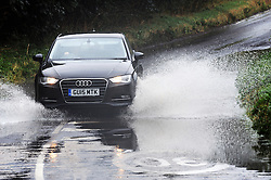© Licensed to London News Pictures. 13/08/2015<br /> Eynsford Road, Crockenhill, Kent is flooded.<br /> Wet weather TODAY (13.08.2015)<br /> A severe weather warning for rain and thunderstorms in London and south east England has been issued by the Met Office.  <br /> <br /> <br /> (Byline:Grant Falvey/LNP)