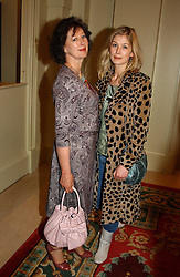 Actress ROSAMUND PIKE and her mother at a fashion show of Sybil Stanislaus Summer 2005 collection with jewellery by Philippa Holland held at The Lanesborough Hotel, Hyde Park Corner, London on 13th April 2005.<br /><br />NON EXCLUSIVE - WORLD RIGHTS