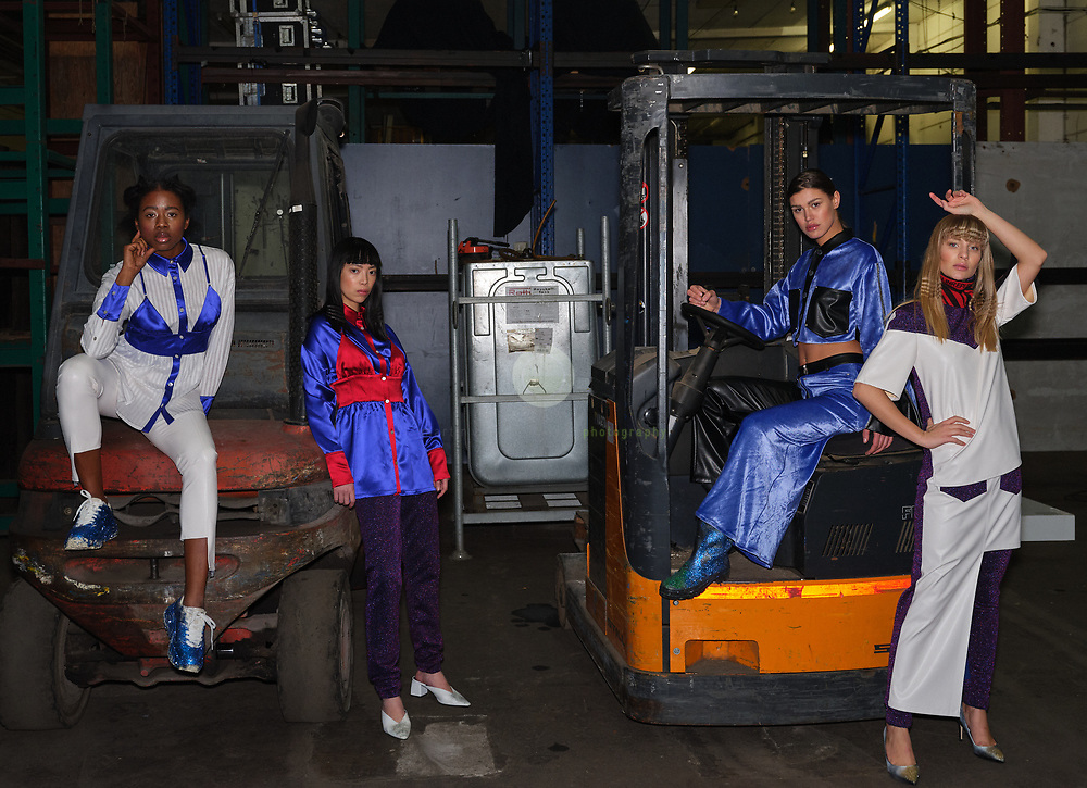 DEU, Deutschland, Berlin, 16.01.2020 /<br /> 4 models pose after the DAMUR fashion show for an impromptu shooting on forklift trucks. Location is the Griessmuehle in Berlin. The fashion show was part of the Berlin Fashion Week, where the new Fall/ Winter 2020 collections were being presented.