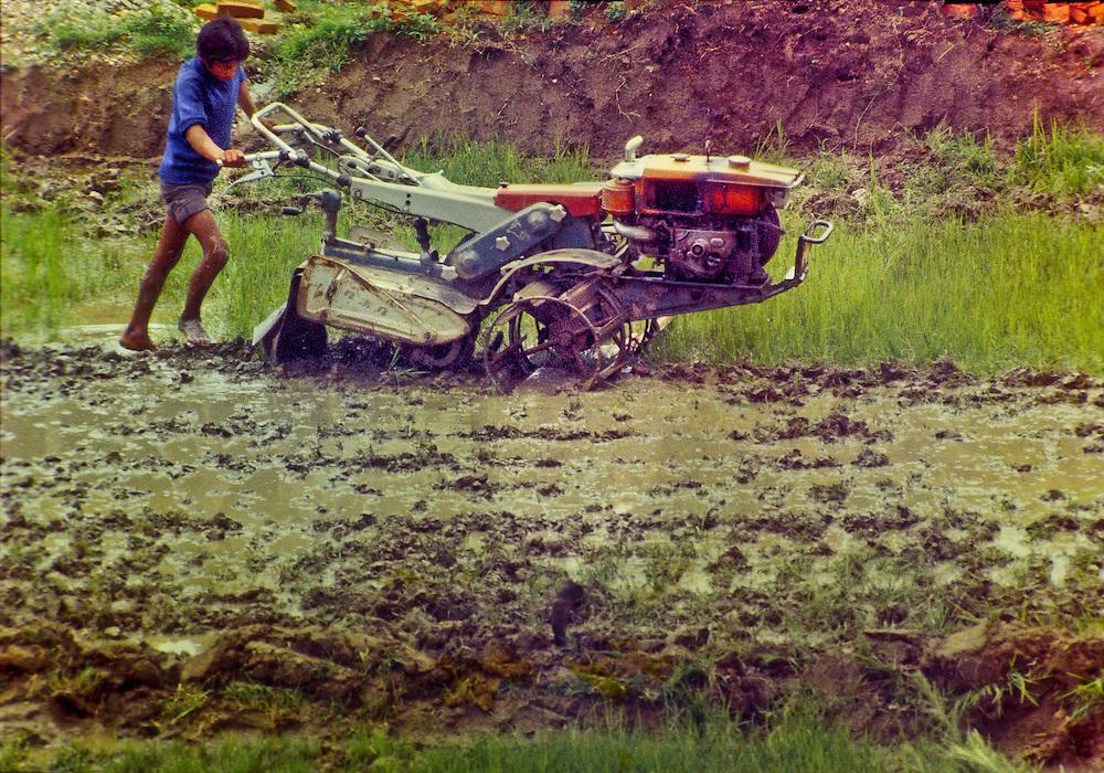 Farmer with a walking tractor in Nepal's Kathmandu Valley