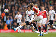 Daley Blind of Manchester United kicks the ball  past Dele Alli of Tottenham Hotspur.Barclays Premier league match, Tottenham Hotspur v Manchester Utd at White Hart Lane in London on Sunday 10th April 2016.<br /> pic by John Patrick Fletcher, Andrew Orchard sports photography.