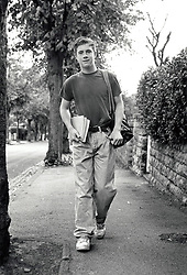 Teenage boy walking down street, Nottingham UK 1991