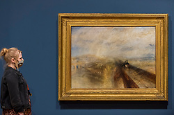 "© Licensed to London News Pictures. 26/10/2020. LONDON, UK. ""Rain, Steam and Speed - the Great Western Railway"", 1830-35, by JMW Turner. Preview of ""Turner's Modern World"", a new landmark exhibition of over 150 works exhibition by JMW Turner at Tate Britain, 28 October to 7 March 2021.  Photo credit: Stephen Chung/LNP"