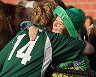 Middletown, New York - A girl hugs a Hamilton High School soccer player after Hamilton defeated Chazy in the New York State Class D boys' soccer championship game on Nov. 20, 2011.