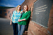 SHOT 4/18/14 7:11:03 PM - Former Columbine High School students Jennifer Hammer, 33, of Commerce City, Co. and Heather Egeland, 32, of Littleton, Co. pose for a portrait at the Columbine Memorial recently. The two are co-founders of The Rebels Project, a support group that has helped survivors of other mass shootings around the country, from Virginia Tech to Chardon, Ohio to Newtown, Conn. On the day of the Columbine shootings in 1999 the two were huddled in the choir office with about 60 other students hiding from the shooters. (Photo by Marc Piscotty / © 2014)