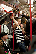 Passenger in deep thought on a Central Line London Underground tube train.