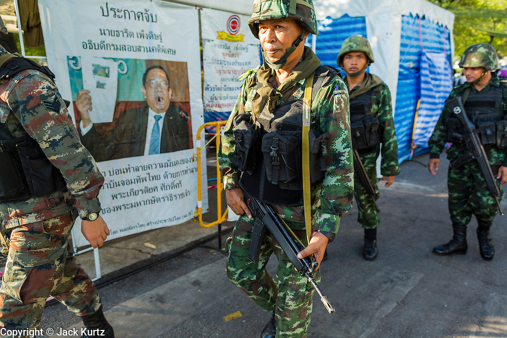 23 MAY 2014 - BANGKOK, THAILAND: Thai soldiers on a foot patrol through the anti-government protest area Friday morning. The Thai military seized power in a coup Thursday evening. They suspended the constitution and ended civilian rule. This is the 2nd coup in Thailand since 2006 and at least the 12th since 1932. The army has ordered both anti-government protestors in Bangkok and pro-government protestors in the suburbs to go home and arrested leaders of both groups.     PHOTO BY JACK KURTZ