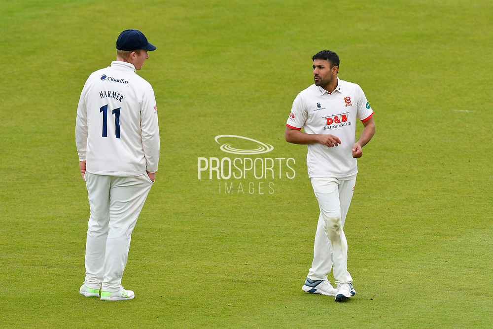 Simon Harmer of Essex and Ravi Bopara of Essex during the first day of the Specsavers County Champ Div 1 match between Hampshire County Cricket Club and Essex County Cricket Club at the Ageas Bowl, Southampton, United Kingdom on 5 April 2019.