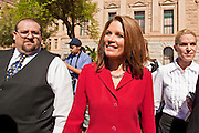 17 OCTOBER 2011 - PHOENIX, AZ:  MICHELE BACHMANN, a Republican candidate for US President, walks through the capitol parking lot after talking to members of the Arizona legislators at the State Capitol in Phoenix. Bachmann met with Republican Arizona legislators and Republican members of the state's Congressional delegation Monday morning to talk about illegal immigration and border security. During the meeting she pledged that if she were elected US President, she would construct a fence along the US - Mexico border.   PHOTO BY JACK KURTZ