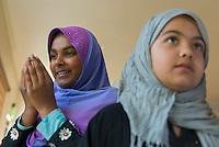 Ruhma Umar of Sacramento and Zainab Ghafoori, 11 (CQ) of Sacramento pray during the opening of the Masjid As-Sabur mosque in Oak Park, Sacramento, Saturday, February 22, 2014.<br /> Brian Baer/Special to the Bee