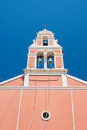 The pink belltower of the Church of Analipsi in Gaios, Paxos, The Ionian Islands, the Greek Islands, Greece, Europe