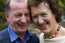 Couple with heads touching affectionately,