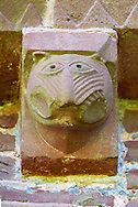 Norman Romanesque exterior corbel no 48  -  sculpture of.a grotesque creature with a long snout and fierce teeth. The Norman Romanesque Church of St Mary and St David, Kilpeck Herefordshire, England. Built around 1140 .<br /> <br /> Visit our MEDIEVAL PHOTO COLLECTIONS for more   photos  to download or buy as prints https://funkystock.photoshelter.com/gallery-collection/Medieval-Middle-Ages-Historic-Places-Arcaeological-Sites-Pictures-Images-of/C0000B5ZA54_WD0s