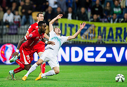 Kevin Kampl of Slovenia faulted by Johan Djourou of Switzerland for penalty shot during football match between National teams of Slovenia and Switzerland at Round 2 of Euro 2016 Qualifications, on October 9, 2014 in Stadium Ljudski vrt, Maribor, Slovenia. Photo by Vid Ponikvar / Sportida.com