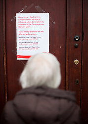 © Licensed to London News Pictures. 19/04/2013. London, UK. Local reads information about the closure, hanged on the post office door during CWU union strike over jobs and closures at Crown Post Office in Holloway, London on April 19, 2013. Photo credit : Peter Kollanyi/LNP