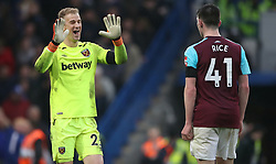 West Ham United goalkeeper Joe Hart (left) and Declan Rice celebrate after the final whistle during the Premier League match at Stamford Bridge, London.