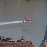 Aerobatic european champion Zoltan Veres of Hungary is seen flying past a rooftop with his airplane during an air show above river Danube crossing central Budapest, Hungary on May 01, 2013. ATTILA VOLGYI