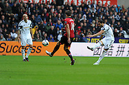 Swansea city's Chico Flores ® hits a long range shot wide of goal. Barclays Premier league, Swansea city v Manchester Utd in Swansea, South Wales on Saturday 17th August 2013. pic by Andrew Orchard ,Andrew Orchard sports photography,