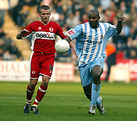 Photo: Chris Ratcliffe.<br />Coventry City v Middlesbrough. The FA Cup. 28/01/2006.<br />Dele Adebola (R) of Coventry gets away from Lee Cattermole of Boro.