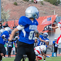 Warriors junior quarterback Dempsey Lincoln (13), finds sophomore wide receiver Preston Keeto (81) in the end zone for a touchdown against Pine Hill, in Navajo on Saturday.