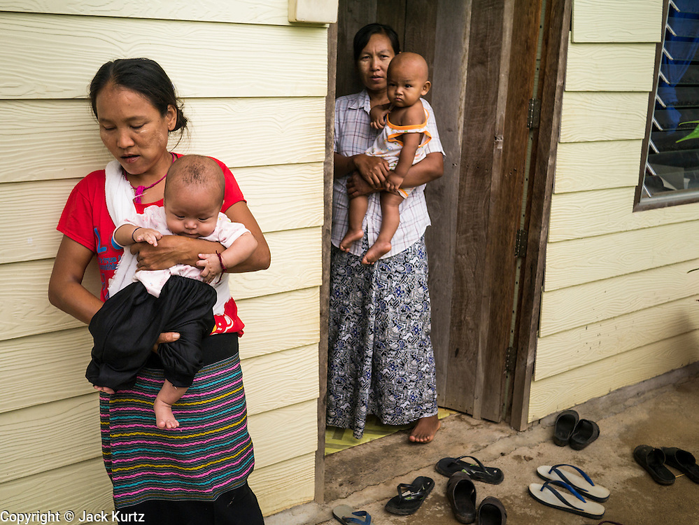 21 MAY 2013 - MAE KU, TAK, THAILAND:  Women and their babies at the SMRU clinic in Mae Ku. Health professionals are seeing increasing evidence of malaria resistant to artemisinin coming out of the jungles of Southeast Asia. Artemisinin has been the first choice for battling malaria in Southeast Asia for 20 years. In recent years though,  health care workers in Cambodia and Myanmar (Burma) are seeing signs that the malaria parasite is becoming resistant to artemisinin. Scientists who study malaria are concerned that history could repeat itself because chloroquine, an effective malaria treatment until the 1990s, first lost its effectiveness in Cambodia and Burma before spreading to Africa, which led to a spike in deaths there. Doctors at the Shaklo Malaria Research Unit (SMRU), which studies malaria along the Thai Burma border, are worried that artemisinin resistance is growing at a rapid pace. Dr. Aung Pyae Phyo, a Burmese physician at a SMRU clinic just a few meters from the Burmese border, said that in 2009, 90 percent of patients were cured with artemisinin, but in 2010, it dropped to about 70 percent and is now between 55 and 60 percent. He said the concern is that as it becomes more difficult to clear the parasite from a patient, progress that has been made in combating malaria will be lost and the disease could make a comeback in Southeast Asia.  PHOTO BY JACK KURTZ