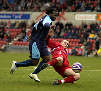 Photo: Matt Bright/Sportsbeat Images.<br /> Swindon Town v Swansea City. Coca Cola League 1. 01/01/2008.<br /> Jamie Vincent of Swindon makes a crucial tackle in the box on Jason Scotland of Swansea