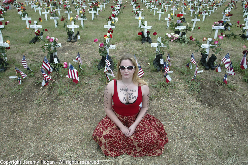 Joanie Hunter Iovino sits silently at Camp Casey II where there are crosses representing the U.S. soldiers killed in Iraq.