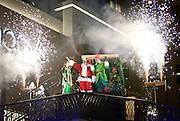 Santa Claus makes a grand entrance during the City Creek Shopping Center holiday celebration, Thursday, Nov. 15, 2012.
