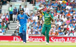 Andile Phehlukwayo of South Africa is frustrated as an edge from Virat Kohli (capt.) of India isn't held by Hashim Amla of South Africa