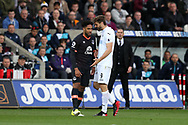 Ashley Williams of Everton (l)  clashes with Fernando Llorente of Swansea city (r). Premier league match, Swansea city v Everton at the Liberty Stadium in Swansea, South Wales on Saturday 6th May 2017.<br /> pic by  Andrew Orchard, Andrew Orchard sports photography.