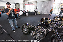 Mike Rabideau of Majik Mike's Customs talks with other bike builders about his bike on display at the Invitational Bike Show at the Harley-Davidson Museum during the Milwaukee Rally. Milwaukee, WI, USA. Saturday, September 3, 2016. Photography ©2016 Michael Lichter.