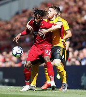 Football - 2018 / 2019 Premier League - Liverpool vs. Wolverhampton Wanderers <br /> <br /> Divock Origi of Liverpool vies with Matt Doherty of Wolverhampton Wanderers at Anfield<br /> <br /> COLORSPORT/BRUCE WHITE