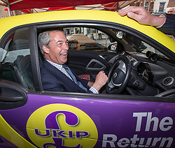 © Licensed to London News Pictures . 05/06/2014 . Newark , Nottinghamshire , UK . UKIP leader NIGEL FARAGE in a UKIP Smart Car on Market Square in Newark today (Thursday 5th June 2014) as voting takes place in the Newark by-election , following the resignation of incumbent Patrick Mercer . Photo credit : Joel Goodman/LNP