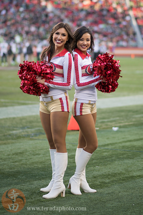 January 1, 2017; Santa Clara, CA, USA; San Francisco 49ers Gold Rush cheerleaders Kiirsta (left) and Aleena (right) during the fourth quarter against the Seattle Seahawks at Levi's Stadium. The Seahawks defeated the 49ers 25-23.