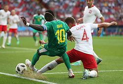 MOSCOW, June 19, 2018  Thiago Cionek (R) of Poland vies with Sadio Mane of Senegal during a Group H match between Poland and Senegal at the 2018 FIFA World Cup in Moscow, Russia, June 19, 2018. Senegal won 2-1. (Credit Image: © Fei Maohua/Xinhua via ZUMA Wire)