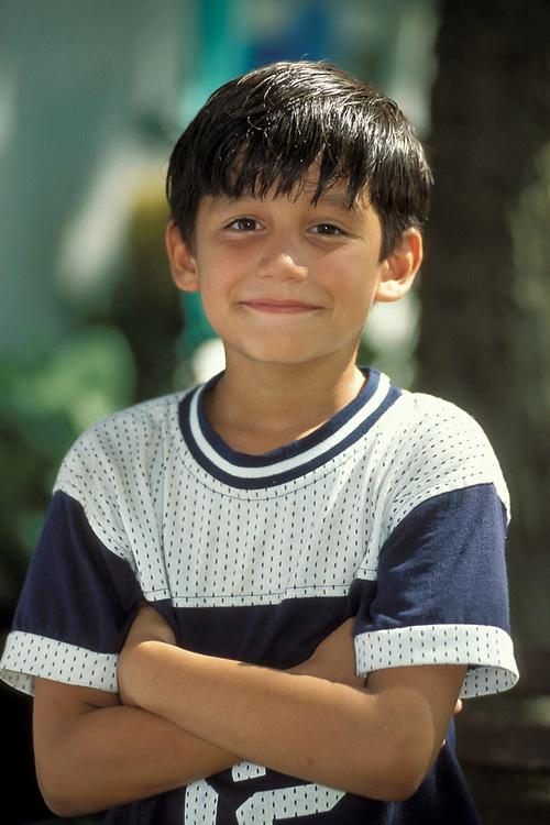 Portrait of young Hispanic boy ages 8.  Model Release.<br /> ©Bob Daemmrich