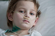 A child in the intensive care unit of the childrens regional hospital,Gomel city in southern Belarus. Chernobyl's human costs are widespread affecting about seven million people.A generation later children are being born with birth defects ,heart problems and thyroid cancer.The crippled economy of Belarus has led to poverty, social problems and domestic abuse..Photograph by Eamon Ward