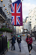 Union Jack flag hanging outside the Crowne Plaza London City hotel in Blackfriars on 1st February 2020 in London, England, United Kingdom.