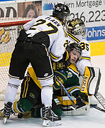 Powell River King Carter Turnbull is pinned between Victoria Grizzlies goaltender Mathew Galajda and forward Lucas Clark at the Q Centre in  Colwood, British Columbia Canada on March 27, 2017.