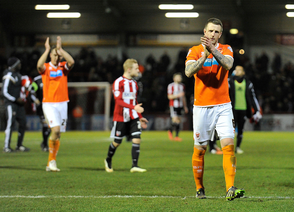 Blackpool's Peter Clarke applauds the travelling fans after the 4-0 defeat to Brentford<br /> <br /> Photographer Ashley Western/CameraSport<br /> <br /> Football - The Football League Sky Bet League One - Brentford v Blackpool - Tuesday 24th February 2015 - Griffin Park - London<br /> <br /> © CameraSport - 43 Linden Ave. Countesthorpe. Leicester. England. LE8 5PG - Tel: +44 (0) 116 277 4147 - admin@camerasport.com - www.camerasport.com