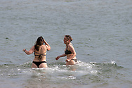 Woman are seen swimming at St Kilda Beach during COVID-19 in Melbourne, Australia. Premier Daniel Andrews comes down hard on Victorians breaching COVID 19 restrictions, threatening to close beaches if locals continue to flout the rules. This comes as Victoria sees single digit new cases. (Photo by Dave Hewison/Speed Media)