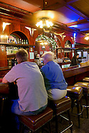 Customers sitting at antique wooden bar, Far Western Tavern, Guadalupe, California