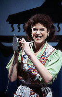 ca. 1977-1979 --- Comedian Gilda Radner spoofs Ronco Products with a Flatco iron in a Saturday Night Live skit. --- Image by © Owen Franken/Corbis