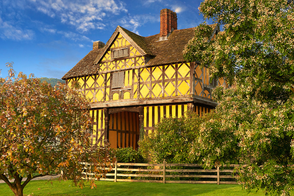 """The half timbered gate house  of the  finest fortified medieval manor house in England built in the 1280s, Stokesay Castle, Shropshire, England . Stokesay Castle is one of the finest surviving fortified manor houses in England, and situated at Stokesay in Shropshire. It was largely built in its present form in the late 13th century by Laurence de Ludlow, on the earlier castle. Architecturally, Stokesay Castle is """"one of the best-preserved medieval fortified manor houses in England"""", according to historian Henry Summerson.[1] The castle comprises a walled, moated enclosure, with an entrance way through a 17th-century timber and plaster gatehouse. Inside, the courtyard faces a stone hall and solar block, protected by two stone towers. The hall features a 13th-century wooden-beamed ceiling, and 17th-century carved figures ornament the gatehouse and the solar. <br /> <br /> Visit our MEDIEVAL PHOTO COLLECTIONS for more   photos  to download or buy as prints https://funkystock.photoshelter.com/gallery-collection/Medieval-Middle-Ages-Historic-Places-Arcaeological-Sites-Pictures-Images-of/C0000B5ZA54_WD0s"""